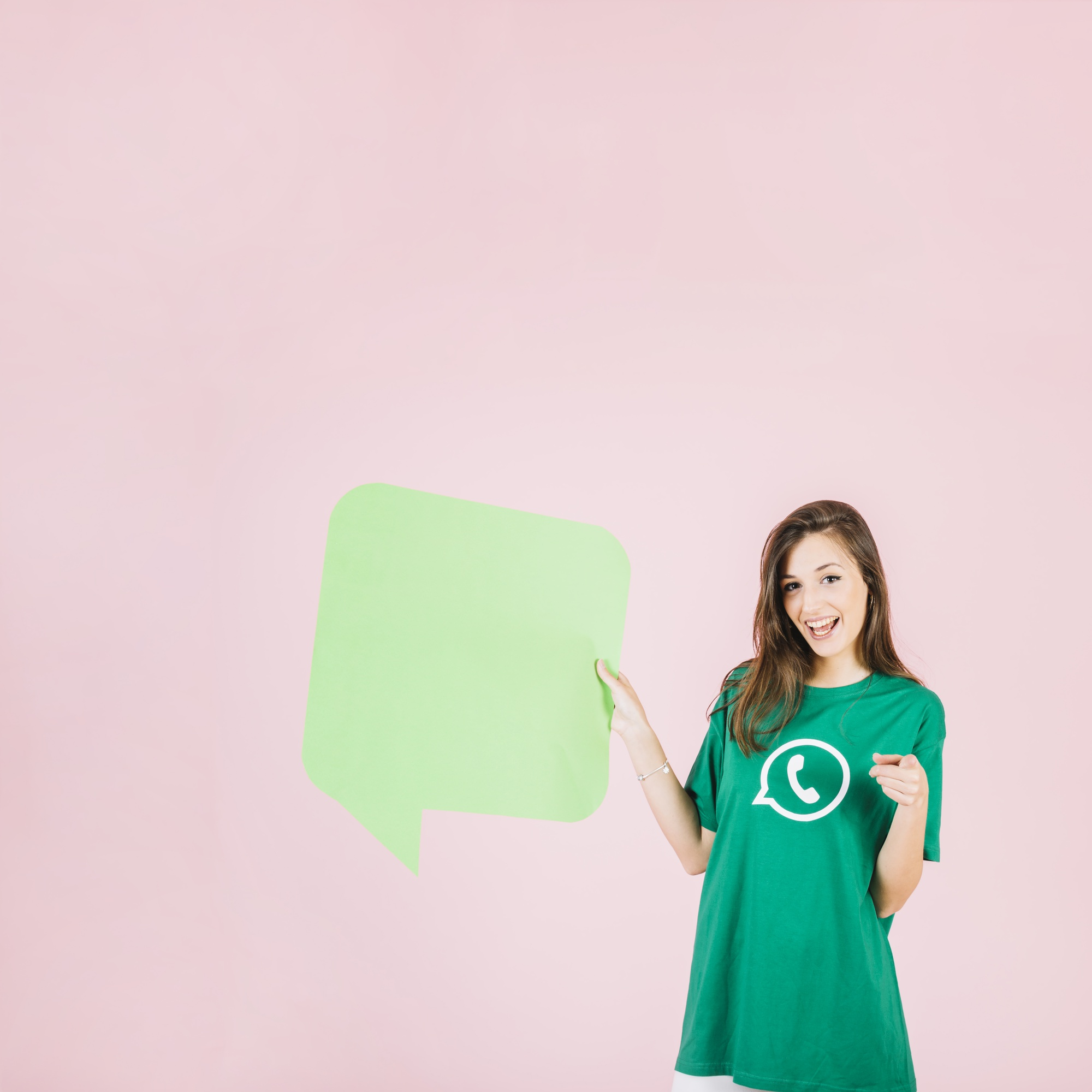 Happy woman holding empty green speech bubble