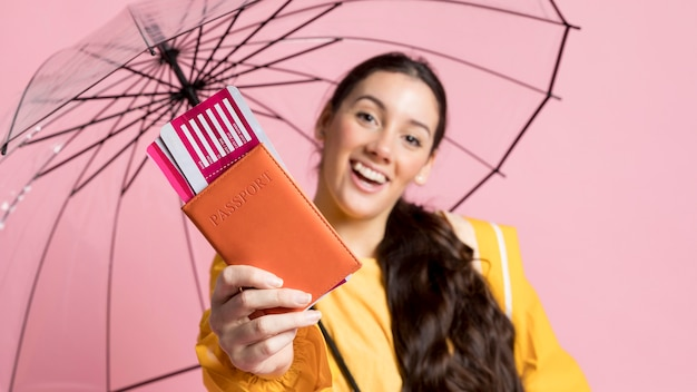 Happy woman holding an opened umbrella