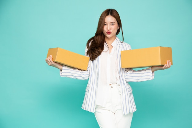 Happy woman holding package parcel box