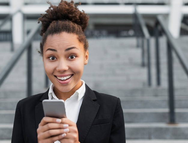Happy woman holding phone