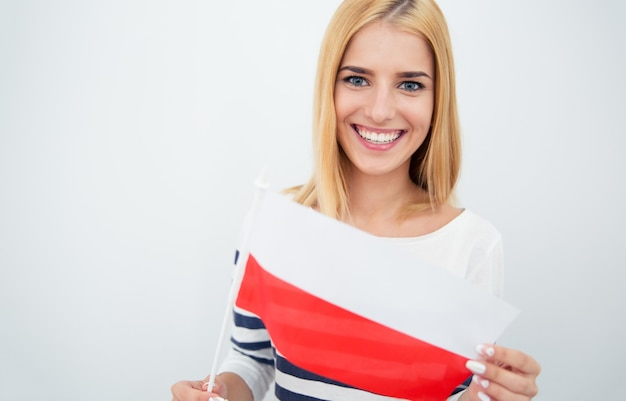 Happy woman holding polish flag