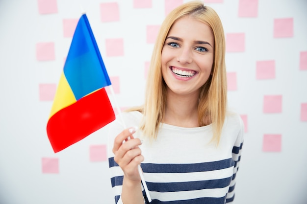 Happy woman holding romanian flag
