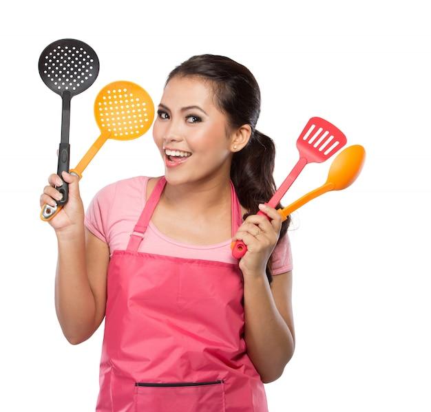 Happy woman holding a spatula
