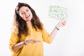 Happy woman holding speech bubble presenting against white background