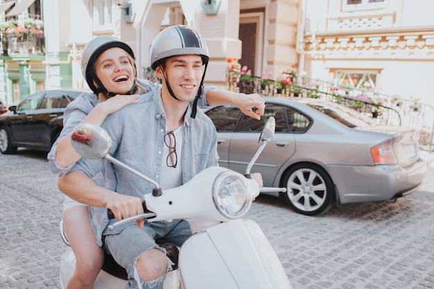 Happy woman is riding on bike with her boyfriend