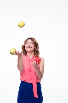 Happy woman juggles with apples