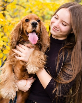 Happy woman in love with cocker spaniel