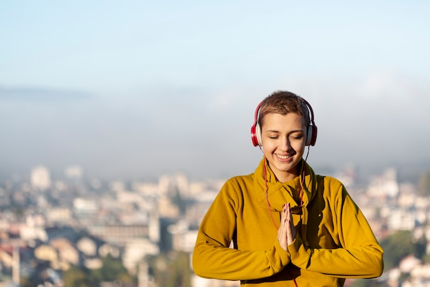 Happy woman meditating medium shot