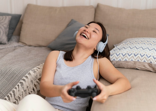 Happy woman playing videogame