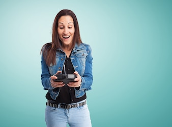 Happy woman playing with a radio control