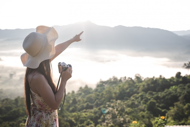 Happy woman pointing on the viewpoint