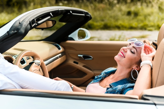 Happy woman portrait in car