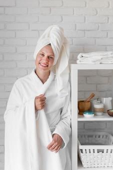 Happy woman posing near natural ingredients