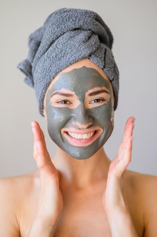 Happy woman posing while wearing face mask