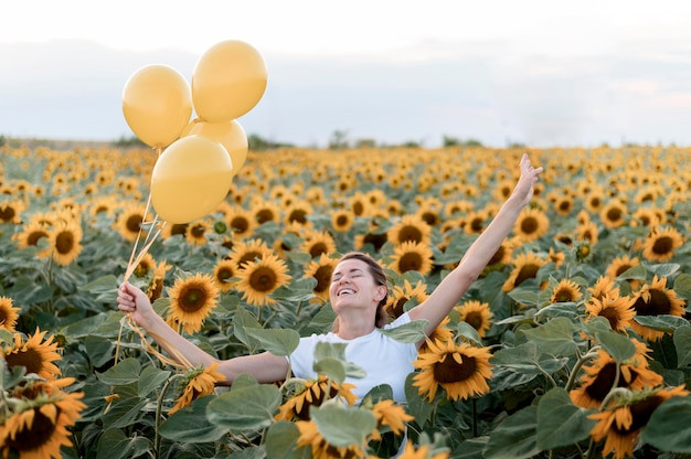 Happy woman posing with balloons