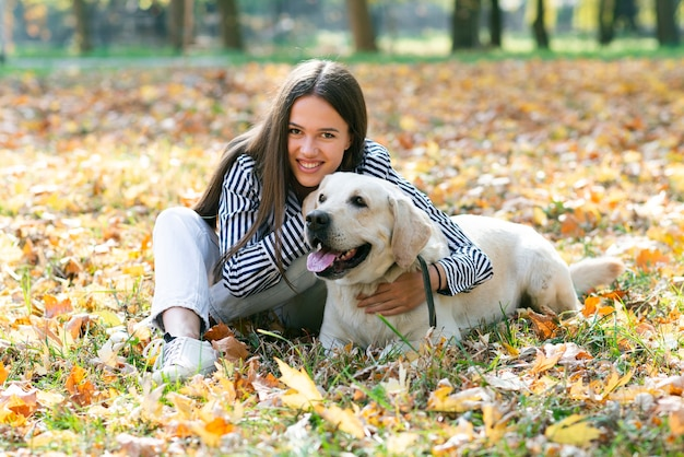 Happy woman posing with cute dog