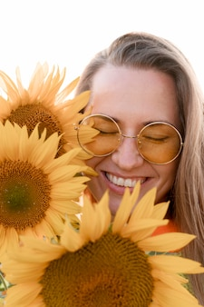 Happy woman posing with sunflowers
