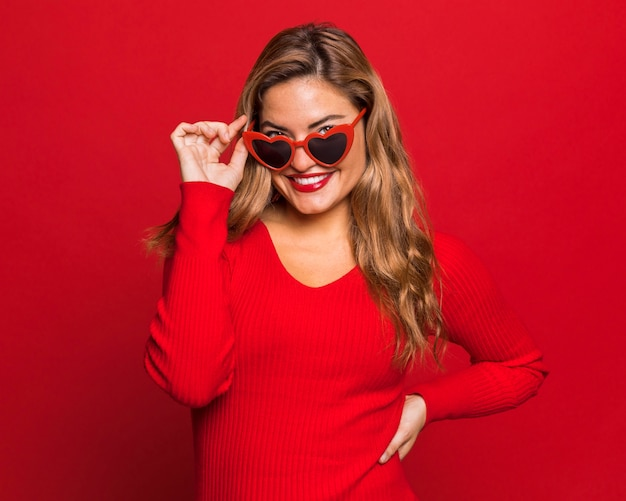 Happy woman posing with sunglasses