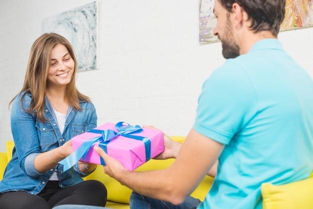 Happy woman receiving gift from her boyfriend