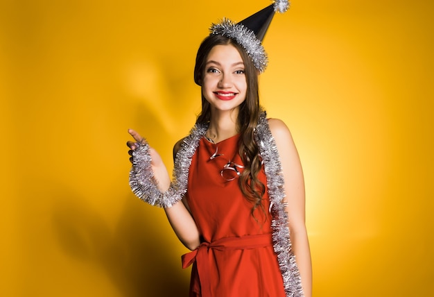 Happy woman in red dress and festive cap
