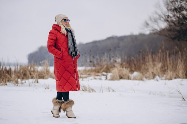 Happy woman in red jacket outside in winter