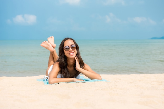 Happy woman relaxing at the beach in summer