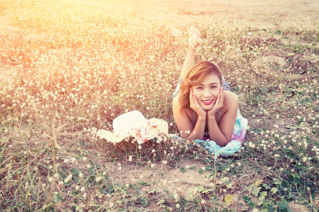 Happy woman resting outdoors