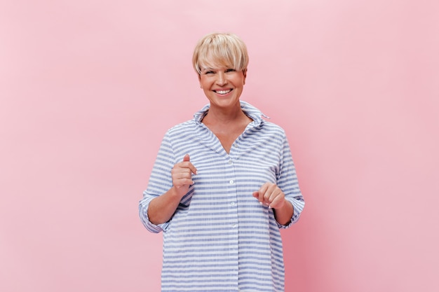 Happy woman in shirt looks with smile into camera