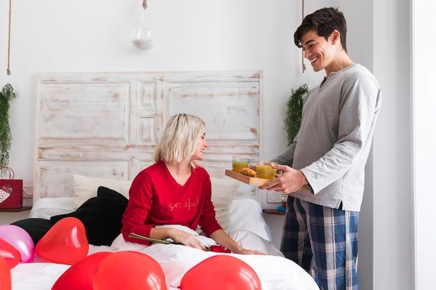 Happy woman surprised by boyfriend