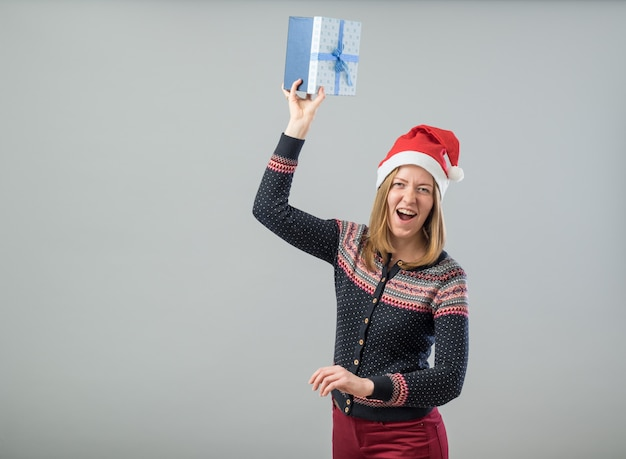 Happy woman throwing present