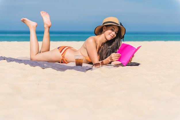 Happy woman traveler relaxing on a perfect beach