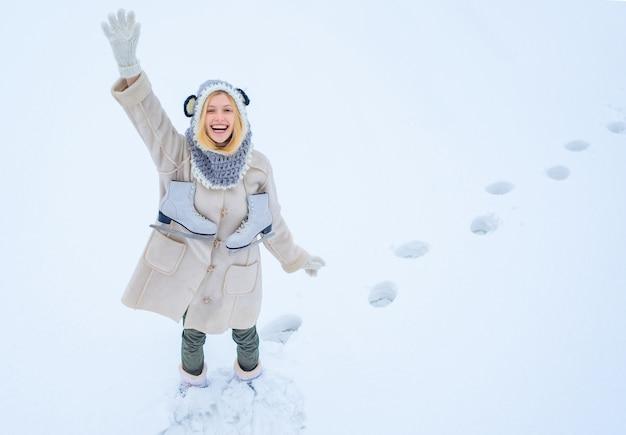 Happy woman walking in winter park.