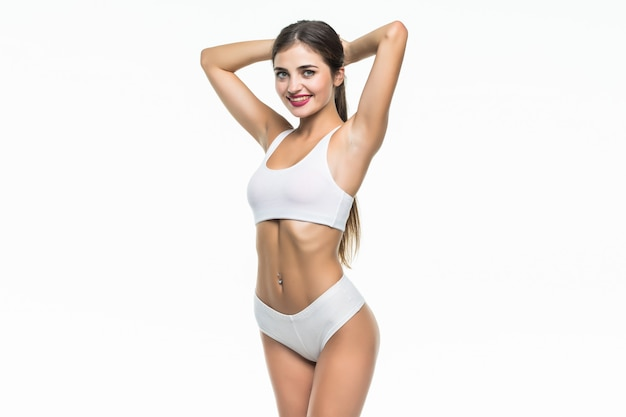 Happy woman in white underwear fit isolated on white wall