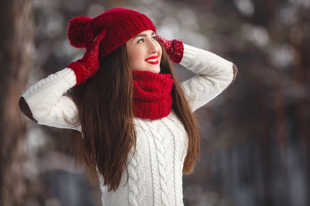Happy woman in winter landscape