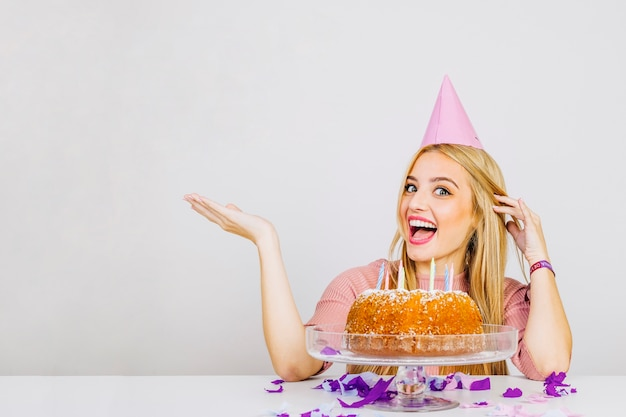 Happy woman with birthday cake