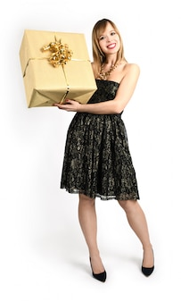 Happy woman with decorated golden box