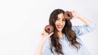 Happy woman with donuts