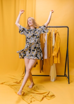 Happy woman with dress in yellow scene