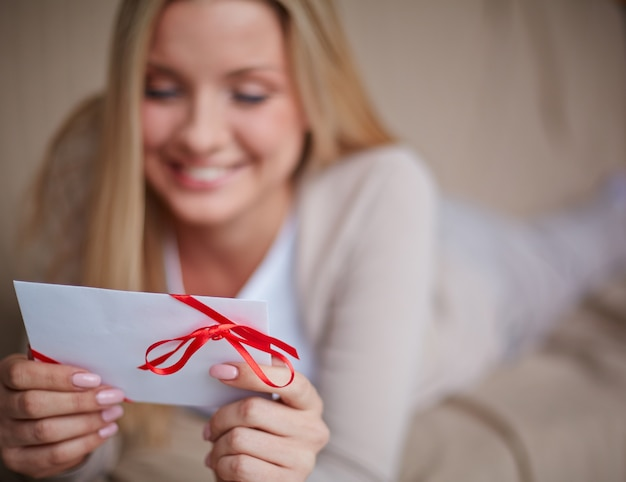 Happy woman with a greeting card