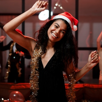 Happy woman with santa hat partying