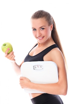 Happy woman with scales and green apple