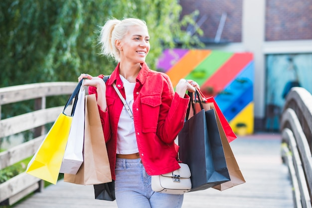 Happy woman with shopping packets