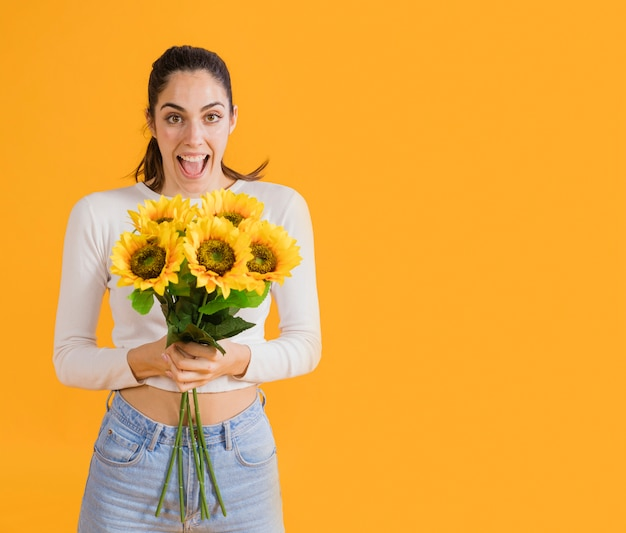 Happy woman with sunflower bouquet