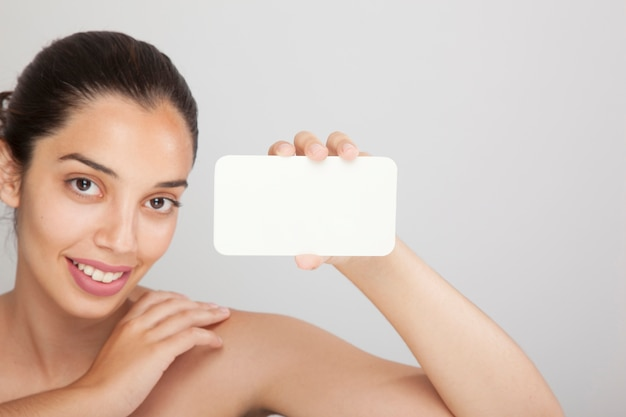 Happy woman with white card