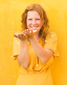 Happy woman yellow background