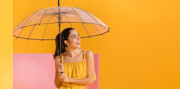 Happy woman in yellow dress