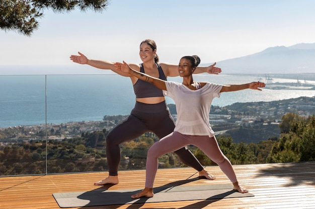 Happy women doing yoga on mat