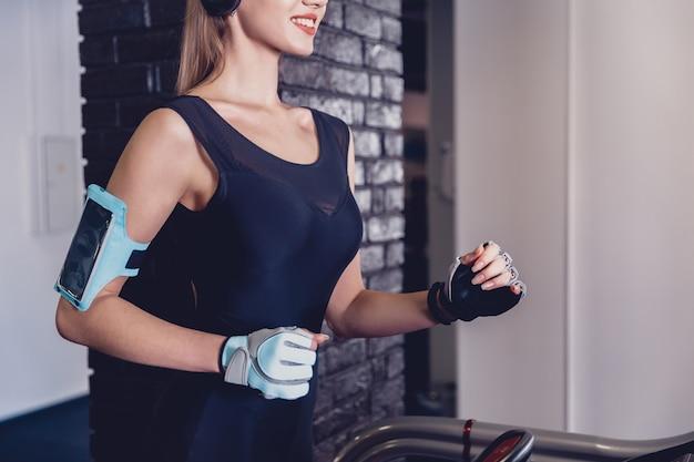 Happy women jogging on a treadmill for health.