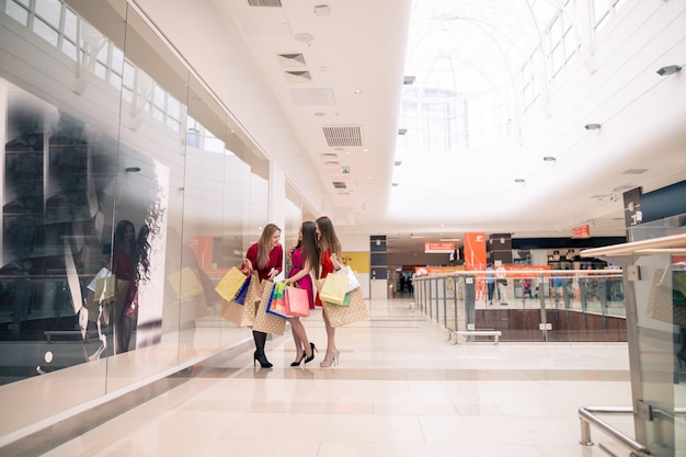 Happy women out shopping at the mall