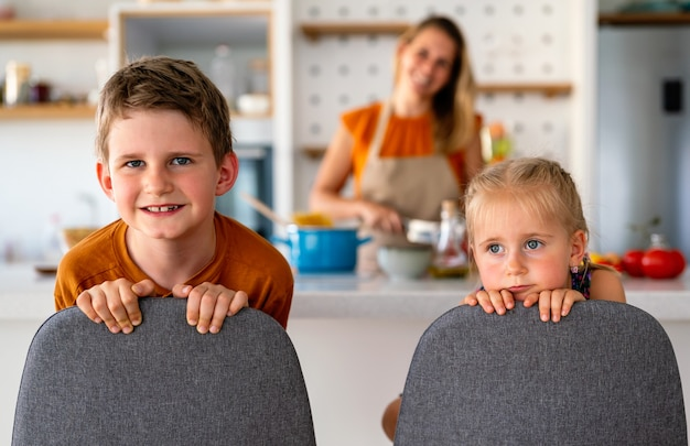 Happy women preparing healthy food and having fun with kid in kitchen. family, food concept